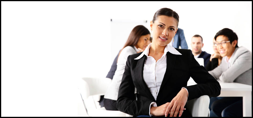 Happy businesswoman sitting in front of business meeting